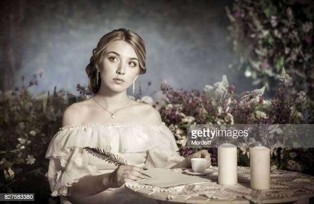 Lovely Woman in Historical White Dress
