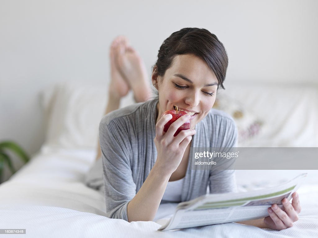 Lovely woman relaxing in bed : Stock Photo