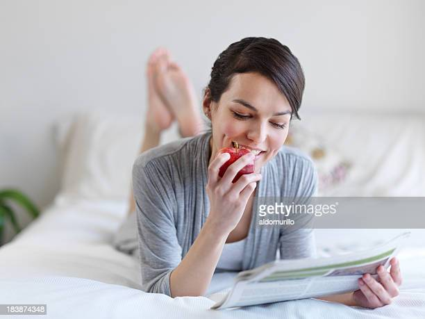 Lovely woman relaxing in bed