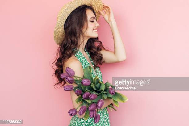lovely woman with purple tulips bunch - purple hat stock pictures, royalty-free photos & images