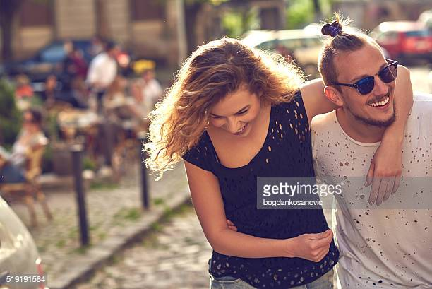 Lovely young couple hugging in the city