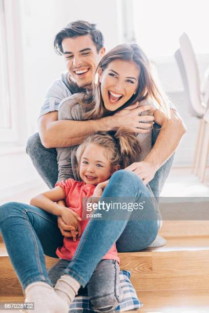 Lovely young family with one child at home