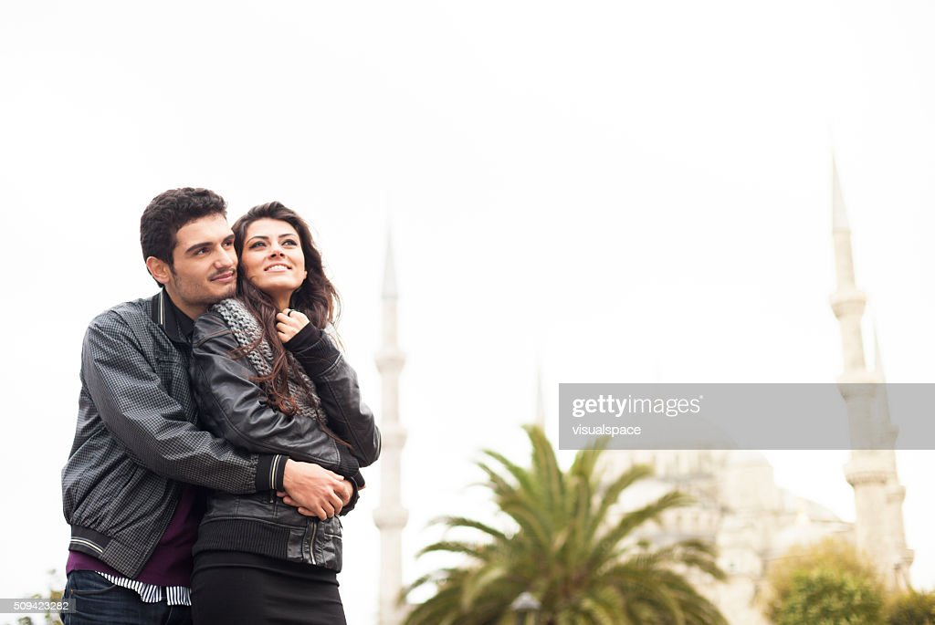 Lovely Young Turkish Couple In Front Of The Blue Mosque : Stock Photo