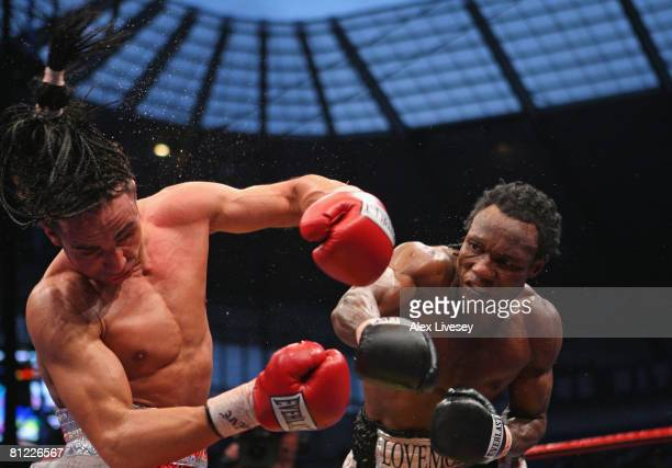 Lovemore N'Dou hits Paulie Malignaggi with a right hand shot during the IBF light-welterweight championship fight between Paulie Malignaggi and...