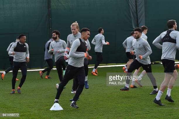 Loverpool players attend a team training session on the eve of the UEFA Champions League first leg quarterfinal football match between Liverpool and...
