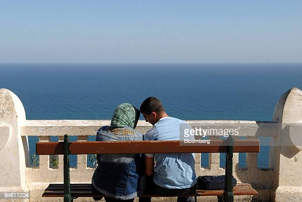 Lovers are seen near Notre Dame d'Afrique church in Algiers Algeria Thursday October 26 2006 Thousands of 'piednoirs'' or black feet as European...