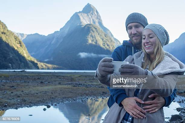 Lovers capture a selfie of romantic moment in remote nature