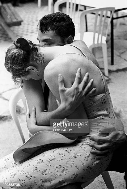 Lovers in Paris France in 1995 Couple in the kingfisher's openair cafe in ChampignysurMarne close suburb of Paris