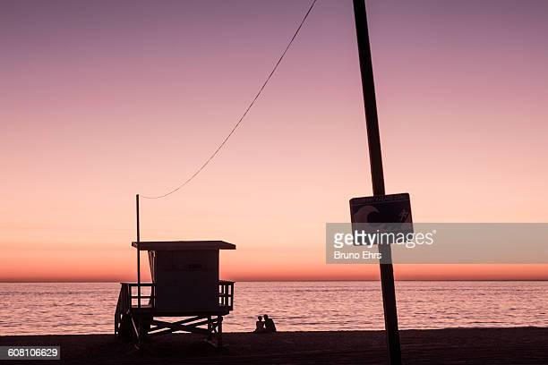 Lovers in sunset at Venice beach