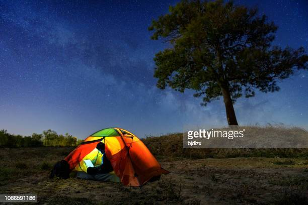 lovers in tents under the milky way - tent stock pictures, royalty-free photos & images