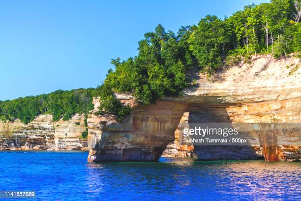 lovers leap! - munising michigan stock pictures, royalty-free photos & images