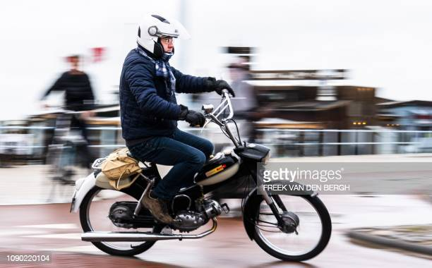 Lovers of Puch and Tomos mopeds ride their vehicle from Scheveningen to The Hague the Netherlands during the 30th edition of the Kouwe Klauwe on...