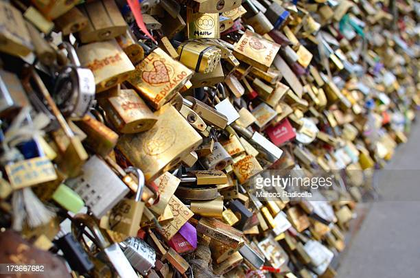 lovers padlocks paris - radicella stock photos and pictures