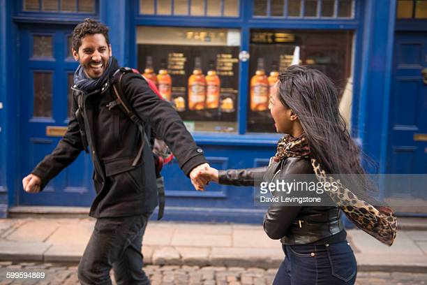 lovers running through the city - temple bar dublin stock photos and pictures