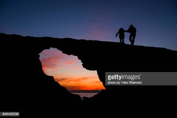 Lovers waiting for sunrise from the rocks
