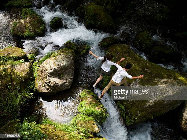 lovers who goes over steep river by cooperating - doing a favor stock pictures, royalty-free photos & images