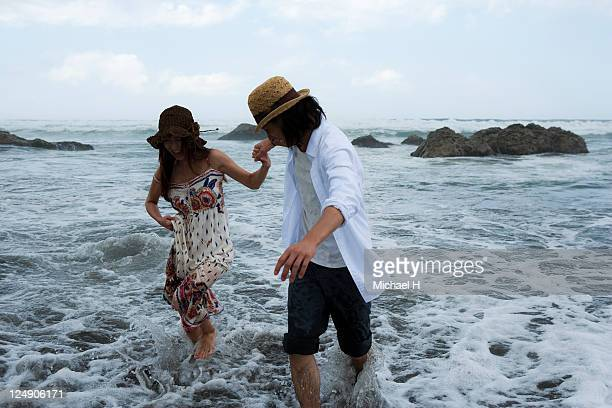 Lovers who join hands and walk along a beach