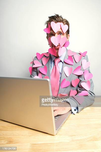 Lovestruck Office Worker Looks Surprised at Computer