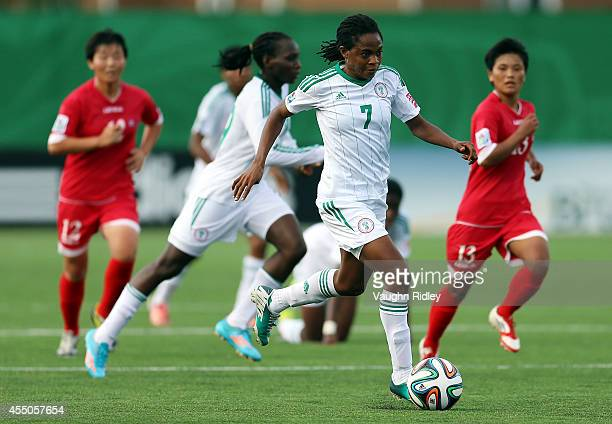 Loveth Ayila of Nigeria in action during the FIFA U20 Women's World Cup Canada 2014 Semi Final match between Korea DPR and Nigeria at Moncton Stadium...