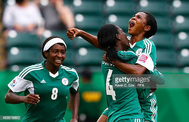 Loveth Ayila of Nigeria reacts after scoring a goal against England with Asisat Oshoala and Courtney Dike during the FIFA U20 Women's World Cup...