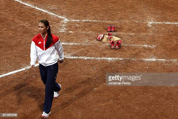 Lovieanne Jung of the United States walks off the field after she left her spikes at home plate after USA lost 31 to Japan during the women's grand...