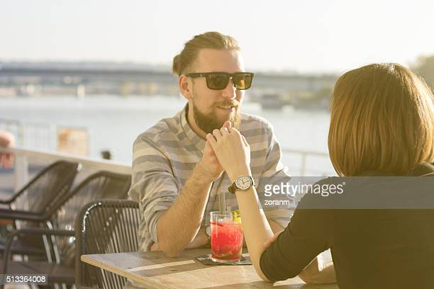 Loving couple at outdoor cafe