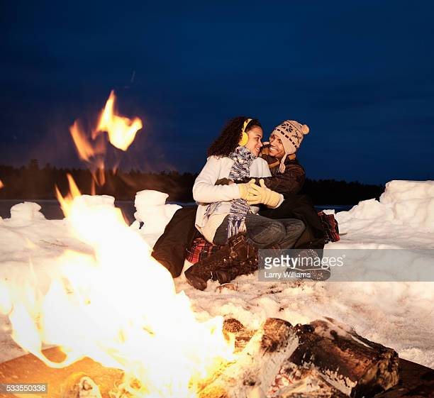 Loving couple by campfire