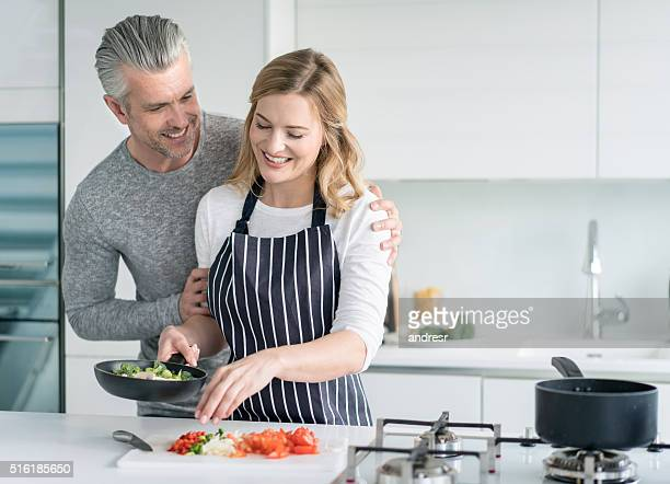 Loving couple cooking at home