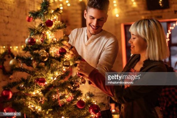 Loving couple decorating Christmas tree together