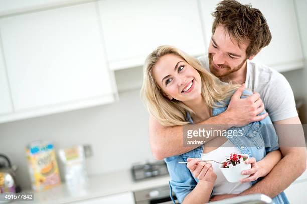 Loving couple eating strawberries for breakfast
