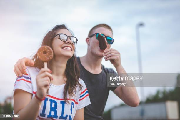 a loving couple eats ice cream - chocolate photos stock pictures, royalty-free photos & images