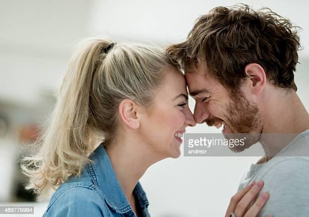 Loving couple eskimo kissing