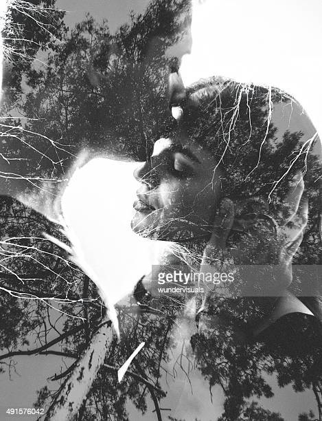 Loving couple image with tree branches in photgraphic effect