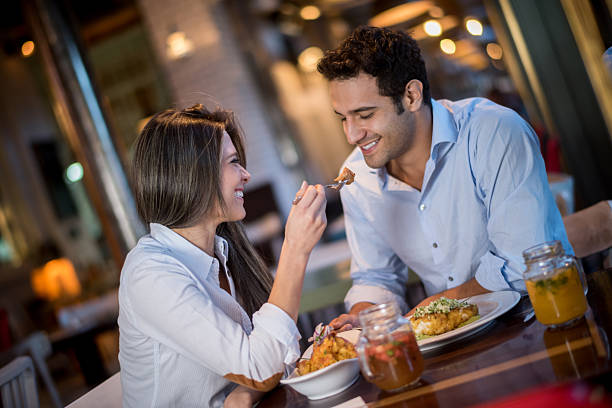 loving couple in a romantic dinner - couples romance stock pictures, royalty-free photos & images