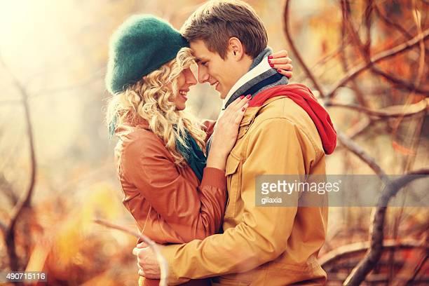 Loving couple in park.