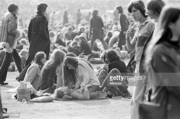 A loving couple in their own world just part of the huge crowd and audience enjoying The Oval Pop Festival Oval Cricket Ground South London in the...