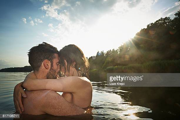 Loving couple kissing in a lake