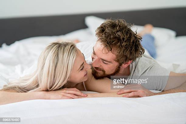 Loving couple laying in bed