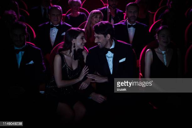 loving couple looking at each other in theater - entertainment event stock pictures, royalty-free photos & images