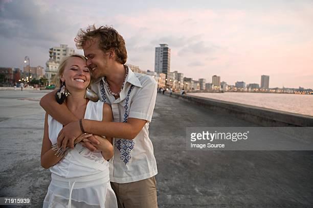 Loving couple on coastal boulevard