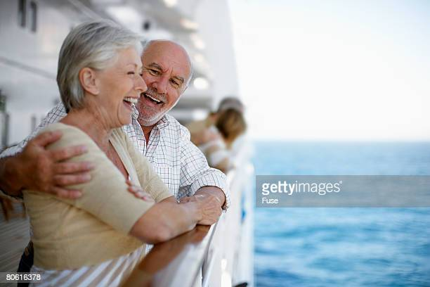 loving couple on cruise ship - passagier wasserfahrzeug stock-fotos und bilder