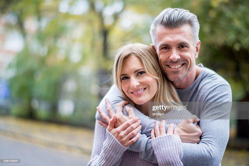 Loving couple outdoors : Stock Photo
