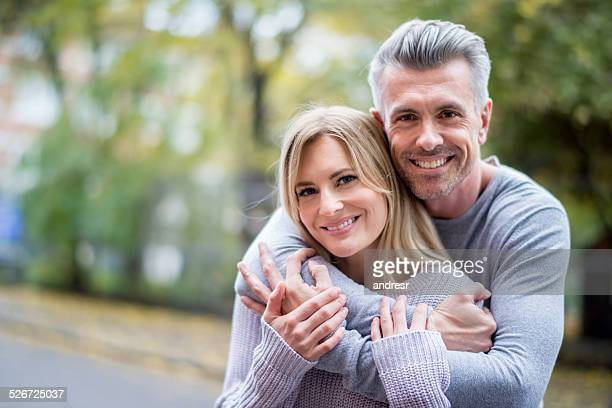 loving couple outdoors - mid volwassen stockfoto's en -beelden