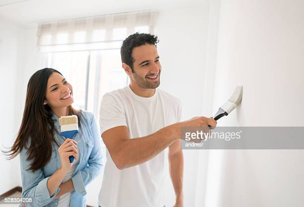 Loving couple painting their house