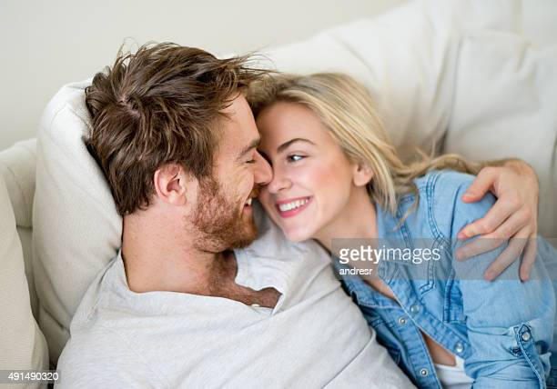 loving couple relaxing at home - girlfriend stock pictures, royalty-free photos & images