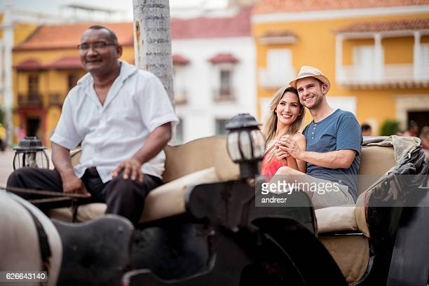 Loving couple riding on a carriage while traveling