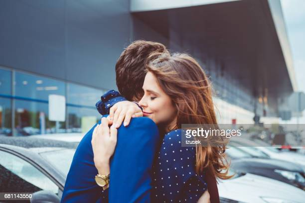 loving couple say good bye at airport