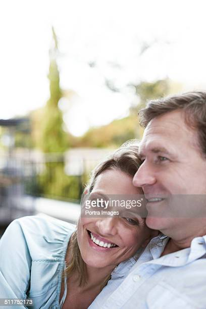 Loving couple sitting at balcony