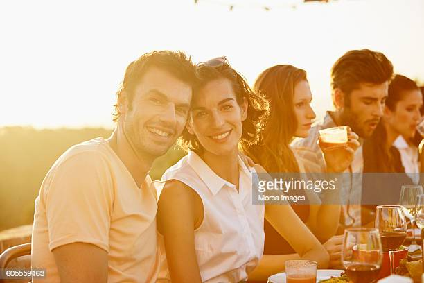Loving couple smiling during social gathering