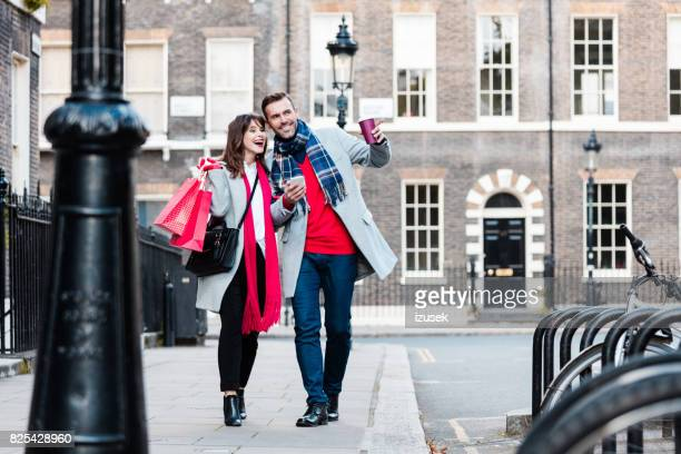 loving couple together on city street - izusek stock pictures, royalty-free photos & images